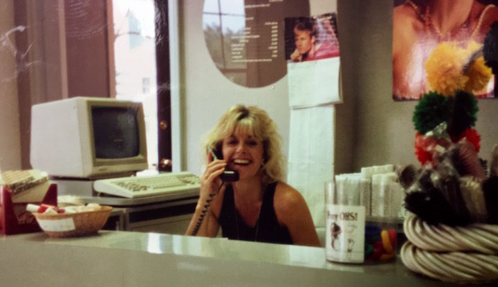 Ann Ratner sits at front desk of Bubbles Salon on Mass Ave in Washington DC