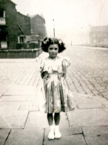 Black and white photo of Bubbles Hair Salons founder Ann Ratner as a young girl in England