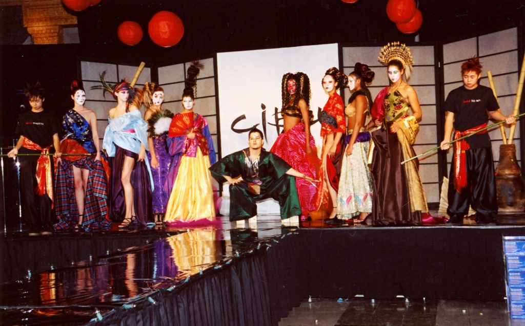 Stage of people in Asian style avant guard costumes from Bubbles Salons launch party for hair care line Cibu
