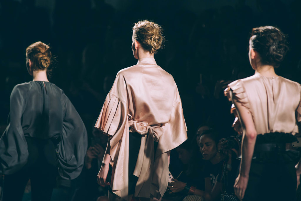 Image of three models with textured updos created by Rodney Cutler for Bubbles Salons at Taoray Wang show during New York Fashion Week