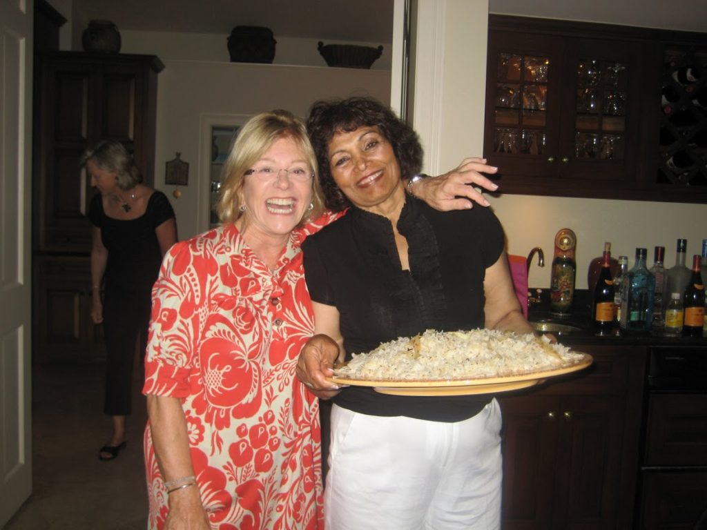 Ann Ratner and Gajo Saini enjoy Gajo's famous curry at Ann's home in Naples, FL