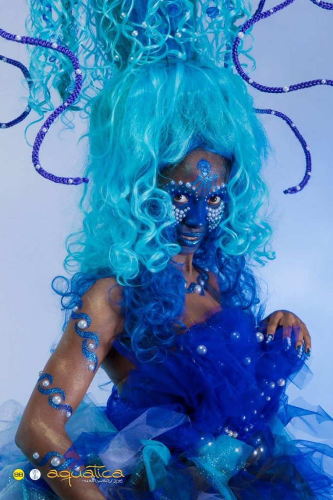 Image of woman in blue Ursala inspired costume and avant guard hairstyle from Bubbles Salons annual Hair Wars competition