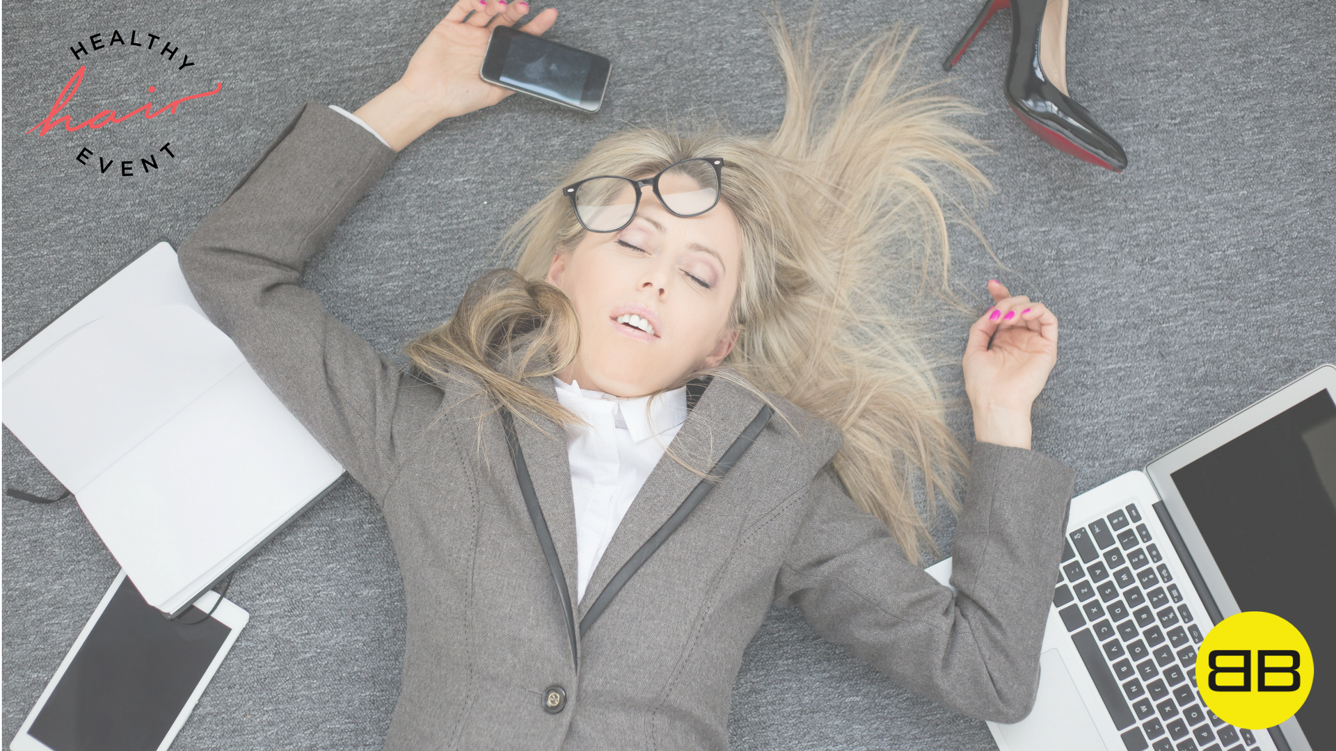 Top 3 Ways Stress Wrecks Your Hair | Image of stressful woman on the floor surrounded by digital devices