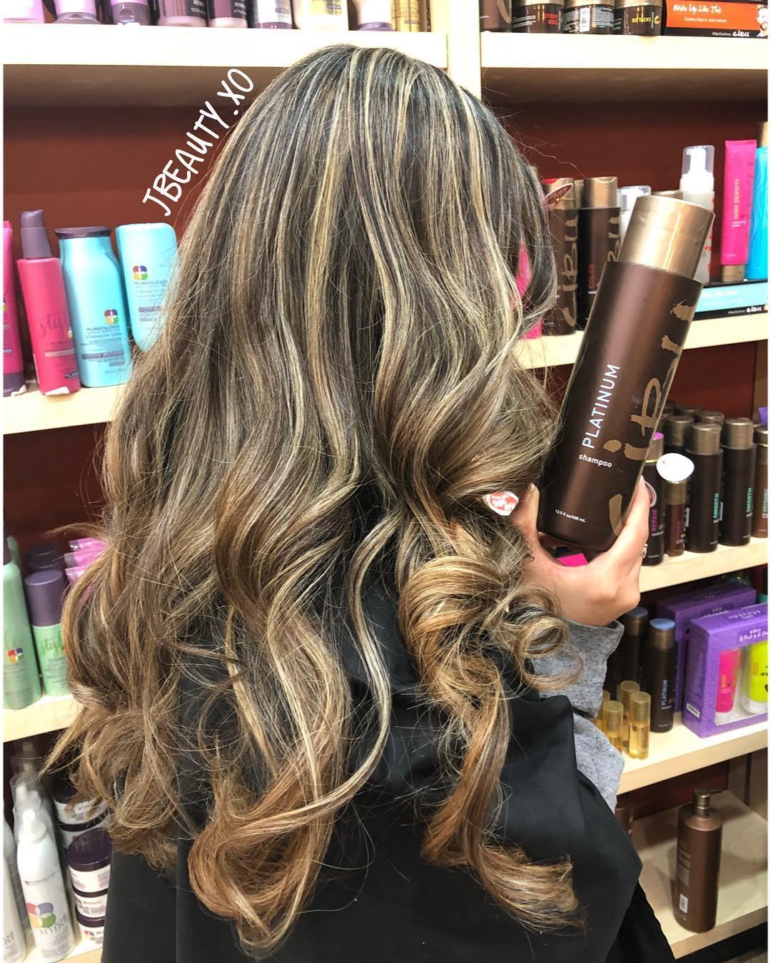 Purple Shampoo   Image of curly hair client holding Cibu Platinum Shampoo