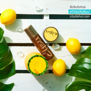 Protect Summer Hair | Image of Cibu Sashini on pool deck with palm froms and lemons