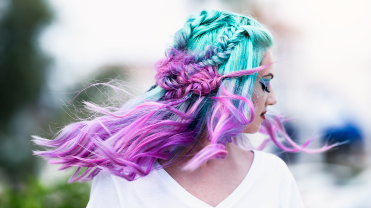 Woman with light blue and purple acid hair