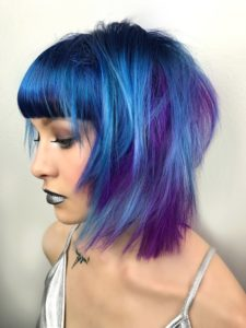 Woman with bright blue & purple Acid Hair